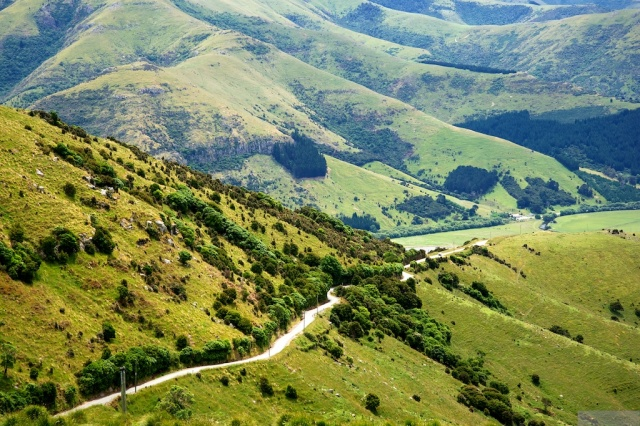 Kinloch Road winding up towards the summit of Banks Peninsula's southern bayNikon D700, Nikkor AFS 24-85mm VR
